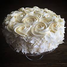 4 layer coconut cake with swiss meringue buttercream frosting