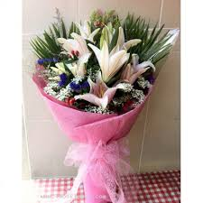 pink lillies 8 pink lilies bouquet wrapped with plastic paper with
