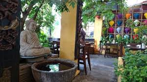 small corner with buddha statue a water pot picture of