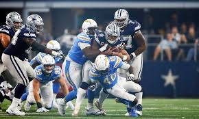 chargers hold cowboys scoreless in half for time in 18