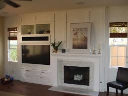 built in white entertainment center next to fireplace cabinet