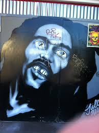 these murals be jammin austin tx beware when riding your bike past east side pies and trailer space records because there is a extra crazy big brown eyed looking robert marley on