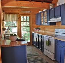 blue kitchen cabinets in cabin cabin style decorating ideas town country living cabin