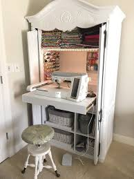 diy craft armoire with fold out table diy sewing cabinet from an old media armoire remodelicious com