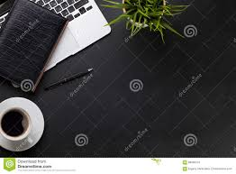 office desk with laptop coffee notepad and plant stock photo