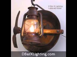 Lantern Wall Sconce Rustic Lantern And Wagon Wheel Wall Sconce Light Fixtures By D Bar