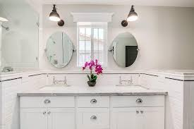 bathroom tilt mirrors white beveled subway tiles with black pencil tiles transitional tilt