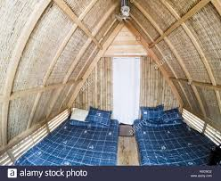 bamboo bed bedroom house bungalow furniture room architecture home stock photo bamboo bed bedroom house bungalow furniture room architecture home bunglow tropical net wood accommodation design white hotel yellow wooden