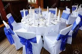 wedding tables and chairs table and chairs decorated in blue and white at wedding reception