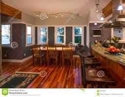 dining room and kitchen breakfast bar with wood floors and granite royalty free stock photo