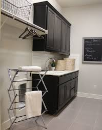 Laundry Room Cabinets With Sinks by White Wooden Floating Cabinet With Double Doors Combined With