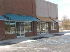 Houston Awning Companies Many Companies Are Now Using A Mix Of Canvas And Metal Awnings On