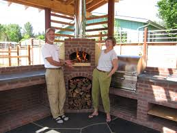 outdoor kitchen with wood fired oven and grill firespeaking