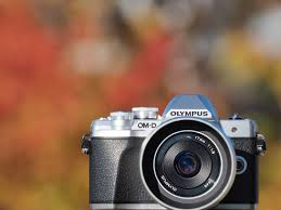 best digital camera for action shots and low light olympus om d e m10 mark iii review digital photography review