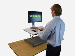 Adjustable Height Laptop Stand For Desk by Changedesk Mini Standing Desk Conversion Uncaged Ergonomics