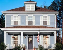 blue house white trim white houses brown roofs sky blue house white trim grey blue