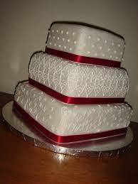 wedding cake with apple red ribbon arteatsbakery