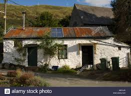 old welsh long house style cottage with whitewashed wall and stock