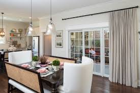 wooden floor in dining room design with white wingback chair and