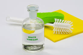 is it safe to use vinegar on wood cabinets white vinegar powerful but use with caution farmer s