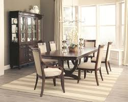 coaster alyssa 7 piece trestle dining room set in dark cognac by
