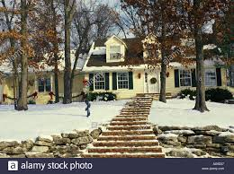 Cape Cod Style Home by Yellow Painted Clapboard Cape Cod Style House In Snow Decorated