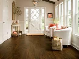 rich brown wood plank flooring luxury vinyl lvp foyer
