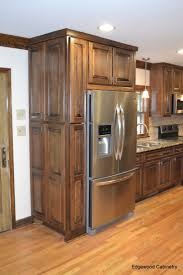 46 best maple cabinets images on pinterest maple cabinets custom maple cabinets finished in a walnut stain and then a black glaze applied