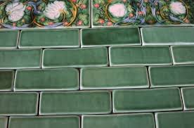 hand crafted field tile with morris pimpernel border by verdant