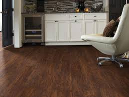 white kitchen cabinets with vinyl plank flooring pros cons of vinyl plank flooring the guys