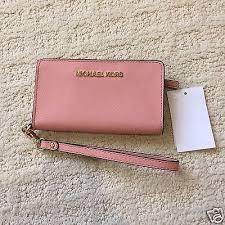 light pink michael kors wristlet buy slim tech wristlet michael kors off69 discounted