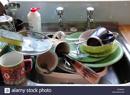 kitchn kitchn sink stacked with dirty pots england uk stock photo