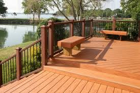 cedar tone solid color wood stain on the deck boards with