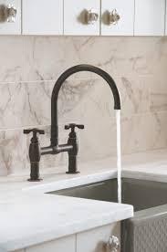 bathroom daltile backsplash with dark moen banbury and lenova