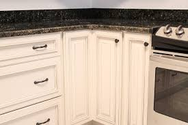 Cabinet Handles For Kitchen White Cabinetry With Dark Hardware Knob On Lazy Susan Cabinet