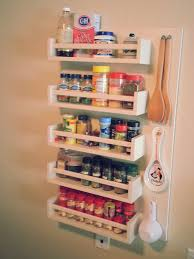diy spice rack for tiny kitchens without storage space 20x32 diy spice rack ikea bekvam spice racks paint brush screws mount on pegboard next to measuring spoons and cups
