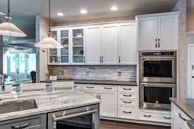 white shaker kitchen cabinets with gray quartz countertops crownsville md k s renewal systems llc