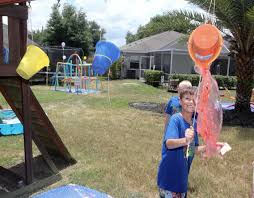 messy obstacle course game use slime shaving cream paint and tarps