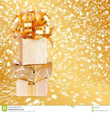 beautiful wrapping paper gift box in gold wrapping paper on a beautiful background stock