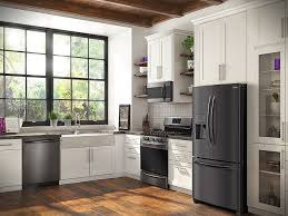 white kitchen cabinets and black stainless steel appliances decor s rich hues are bolder for fall the daily