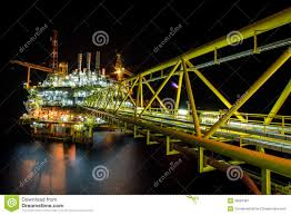oil rig at night with twilight background royalty free stock