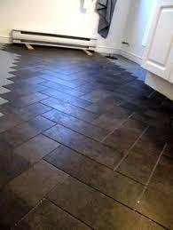 stone effect herringbone floor using camaro luxury vinyl tiles in