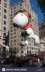 the snoopy the flying ace helium filled balloon floats overhead