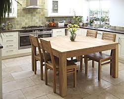 square teak table with modern low back chairs perfect for this