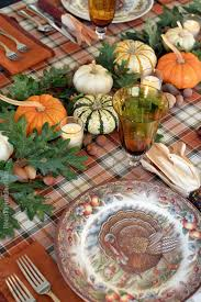 thanksgiving table with turkey a thanksgiving table with turkey plates plaid and pumpkin oak leaf
