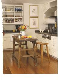 kitchen appealing four black wheels placed on the brown wooden