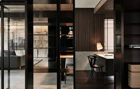 slatted room divider black acrylic glass and stone form this dark and sophisticated