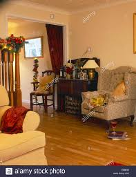 Beige Wingback Chair Beige Wingback Chair In Living Room With Oak Flooring And Old
