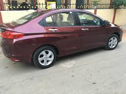 honda city vx cvt carnelian red pearl ownership review