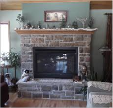 photos hgtv painted brick fireplace with rustic wood mantel loversiq